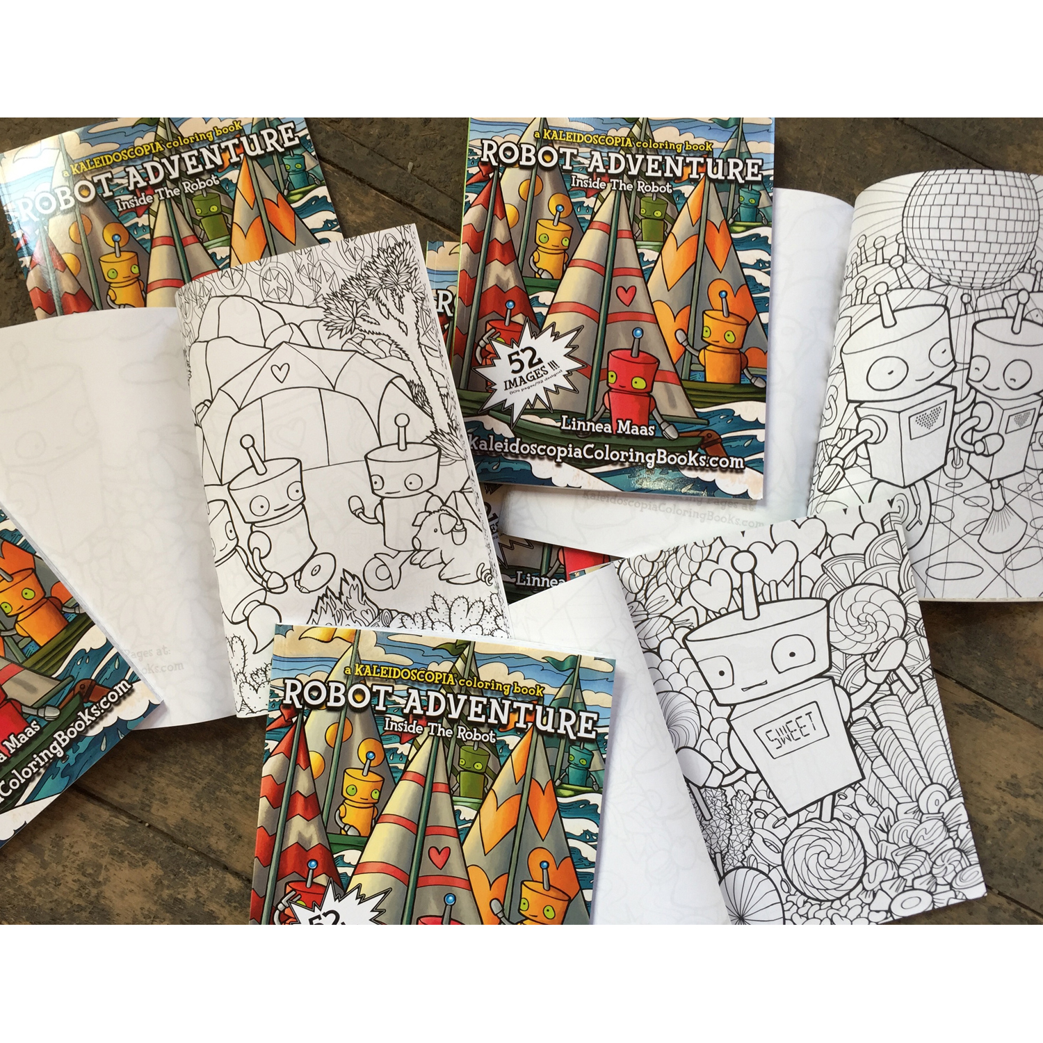 View of coloring books open on the floor, Robot Adventure: Insid