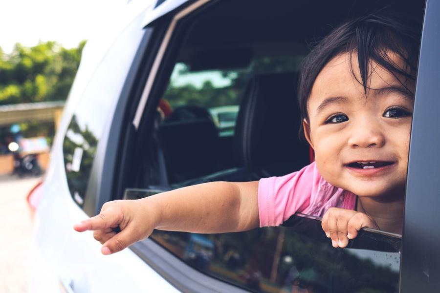 happy little girl in car