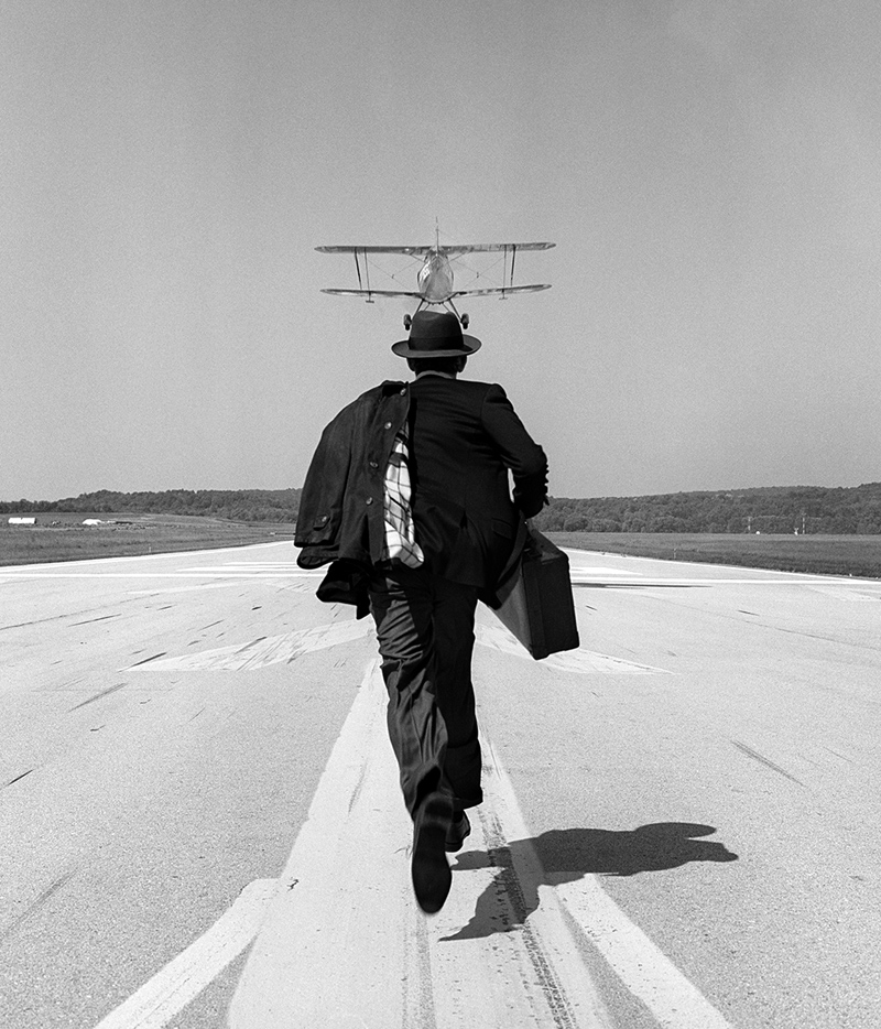 RODNEY SMITH A.J. Chasing Airplane, Orange County Airport, NY, 1998