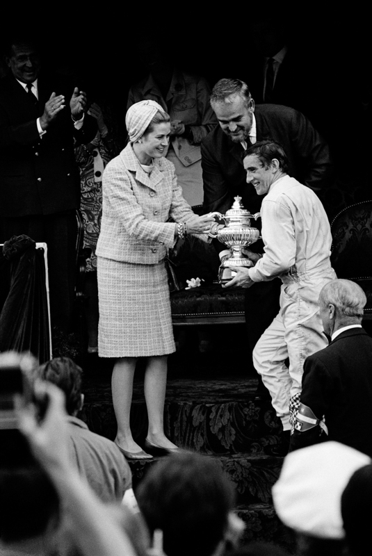 JESSE ALEXANDER,  Jackie Stewart Receiving Winner's trophy from Princess Grace and Prince Rainier,  Monaco, 1966