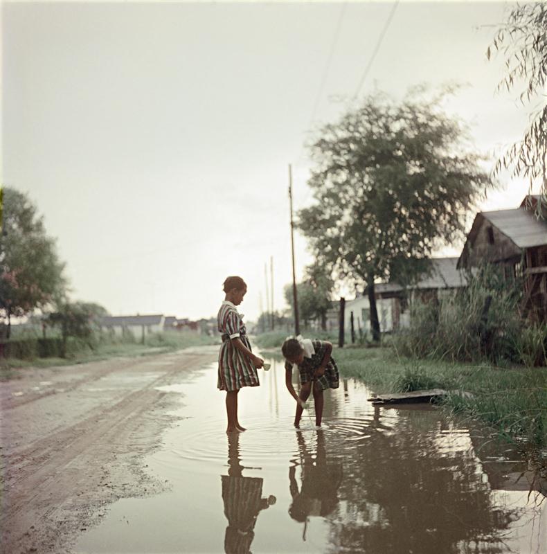 GORDON PARKS, Untitled  (Two Girls in Puddle), Alabama, 1956                                                           © The Gordon Parks Foundation