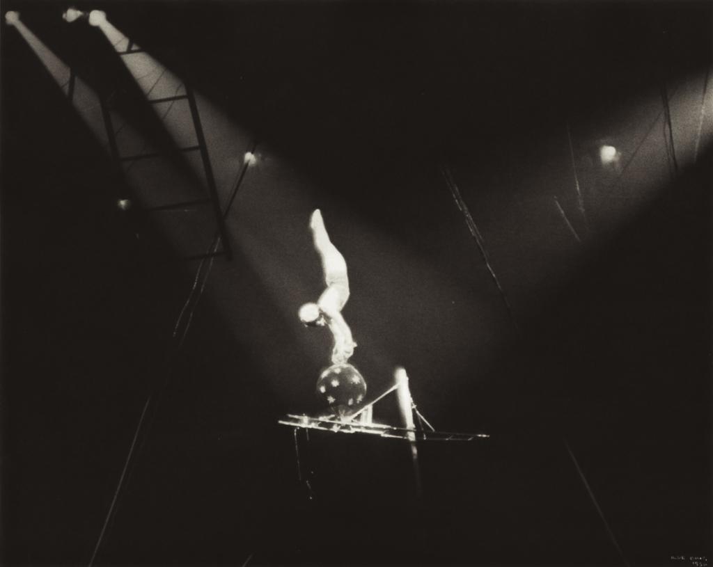 ILSE BING,  Circus Acrobat on Black Ball, New York, 1936