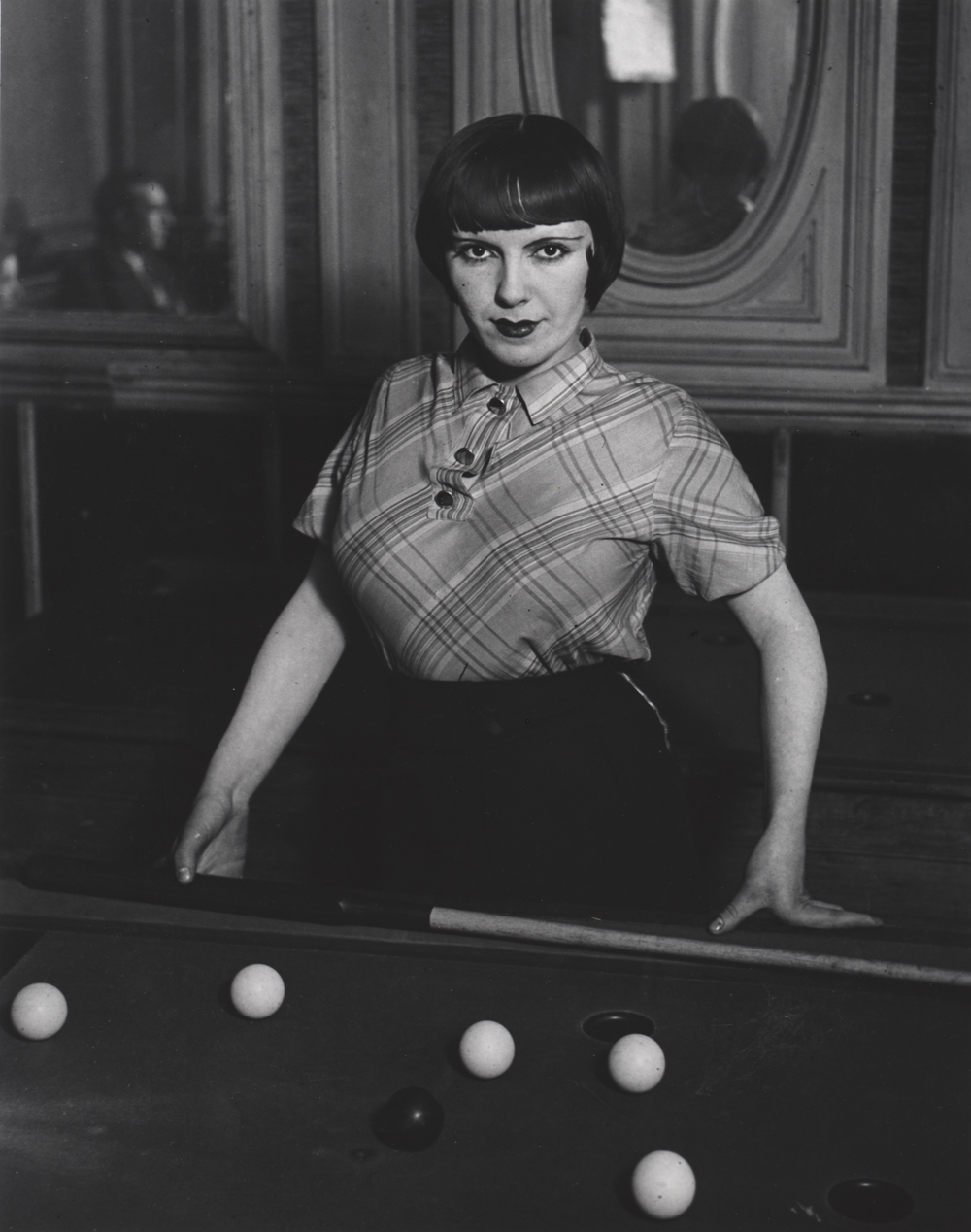 BRASSAI,  Girl Playing Russian Billiards ,  Montmartre, Paris,  1933