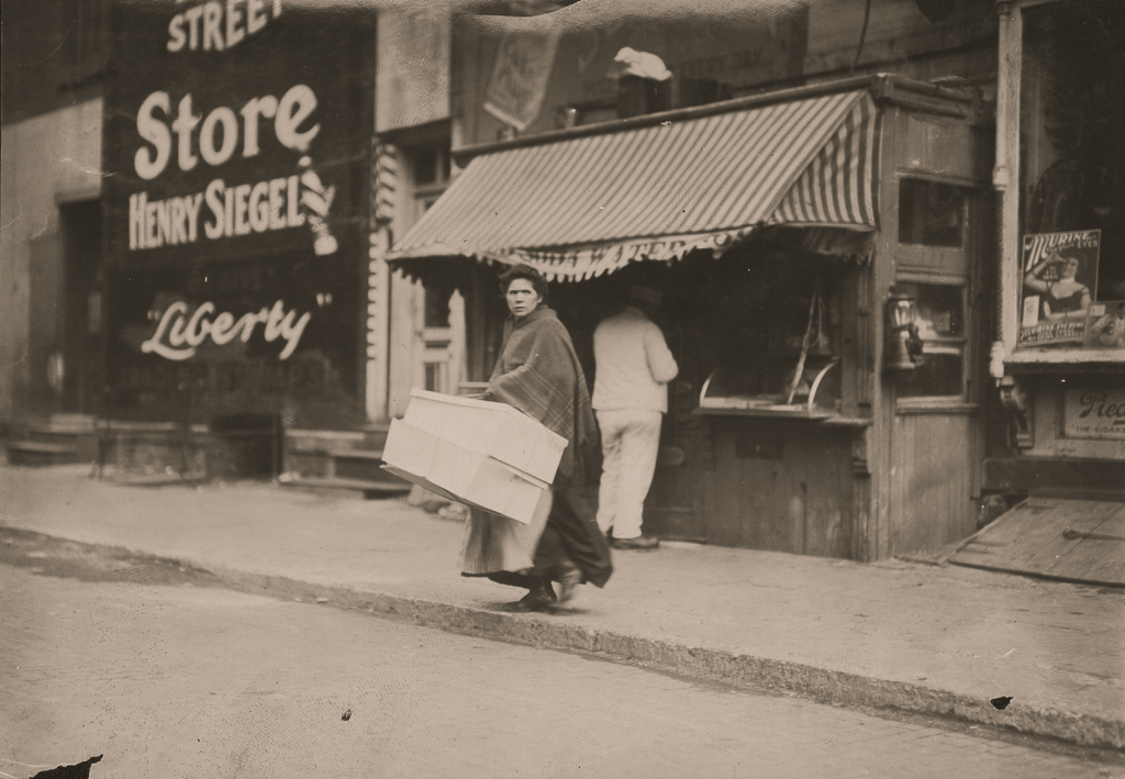 LEWIS WICKES HINE,  A Mother Carrying Flowers Home , New York City, 1912