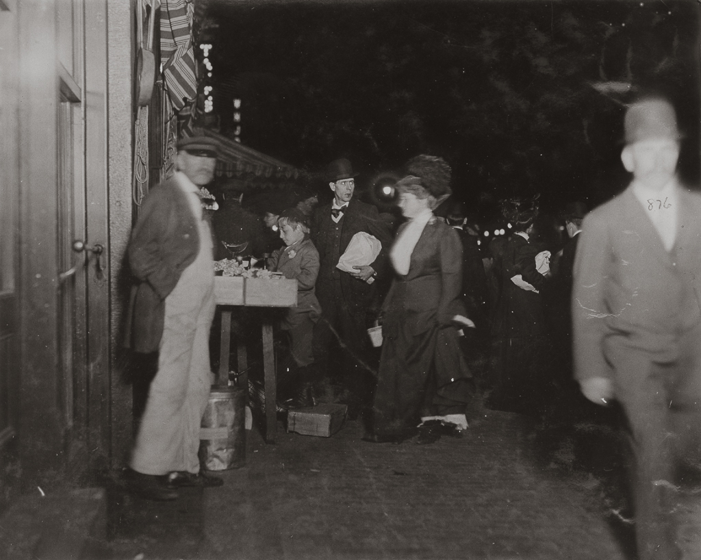 LEWIS WICKES HINE,  Small Vendor Selling Late at Night in Boston Market ,  Boston, Massachusetts , 1909