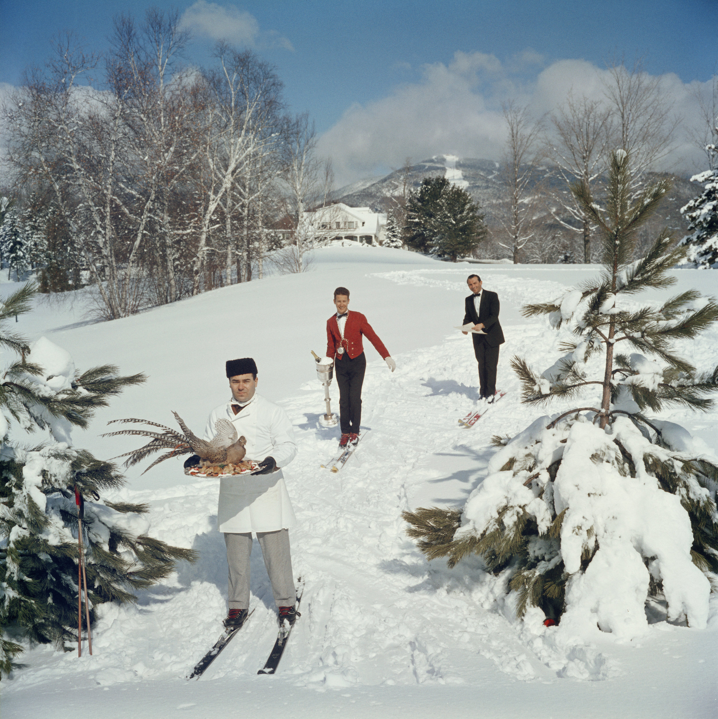 SLIM AARONS,  Skiing Waiters , 1960,courtesy Getty Image Archive