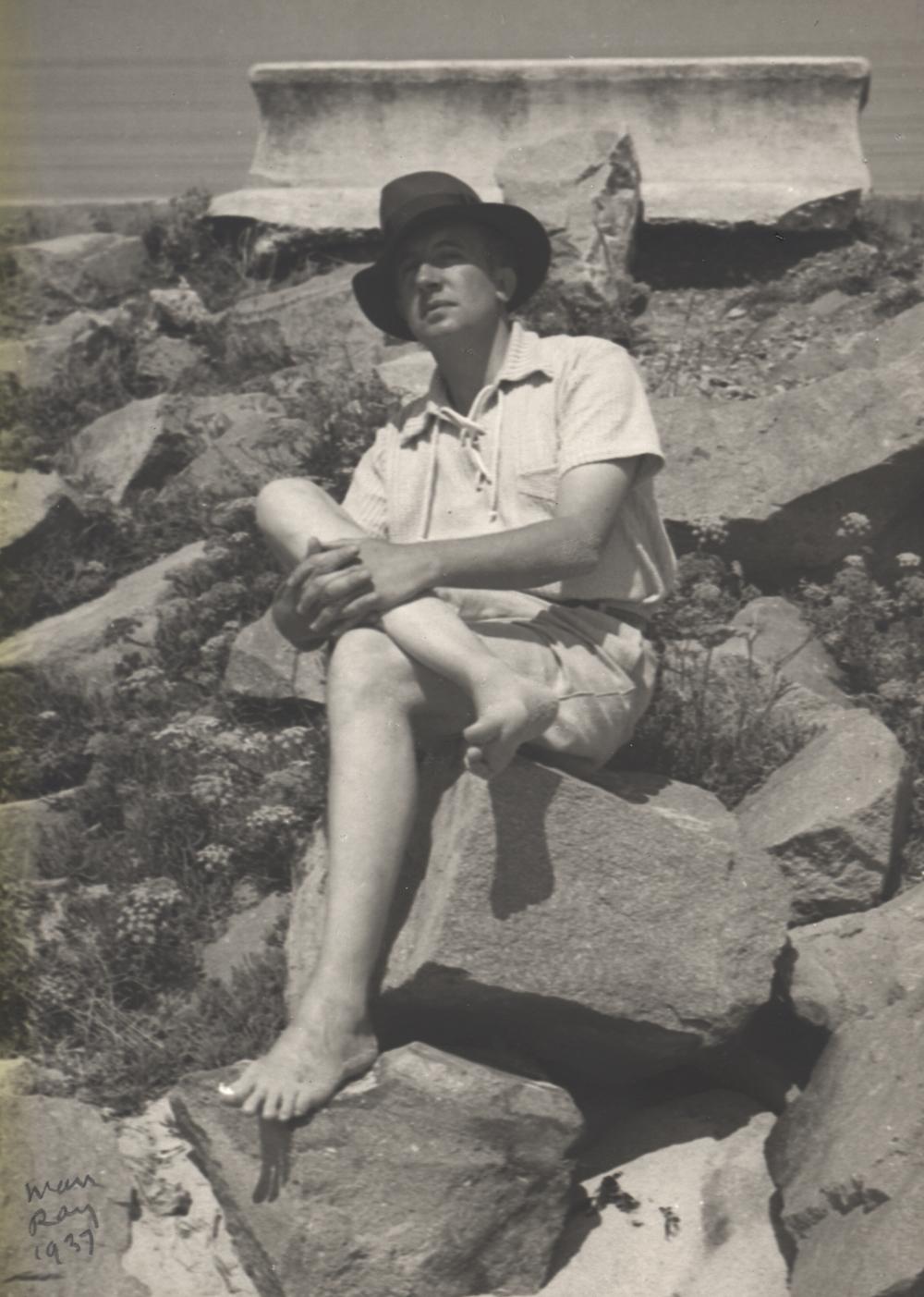 MAN RAY,  Paul Eluard Seated on Breakwater,  1937