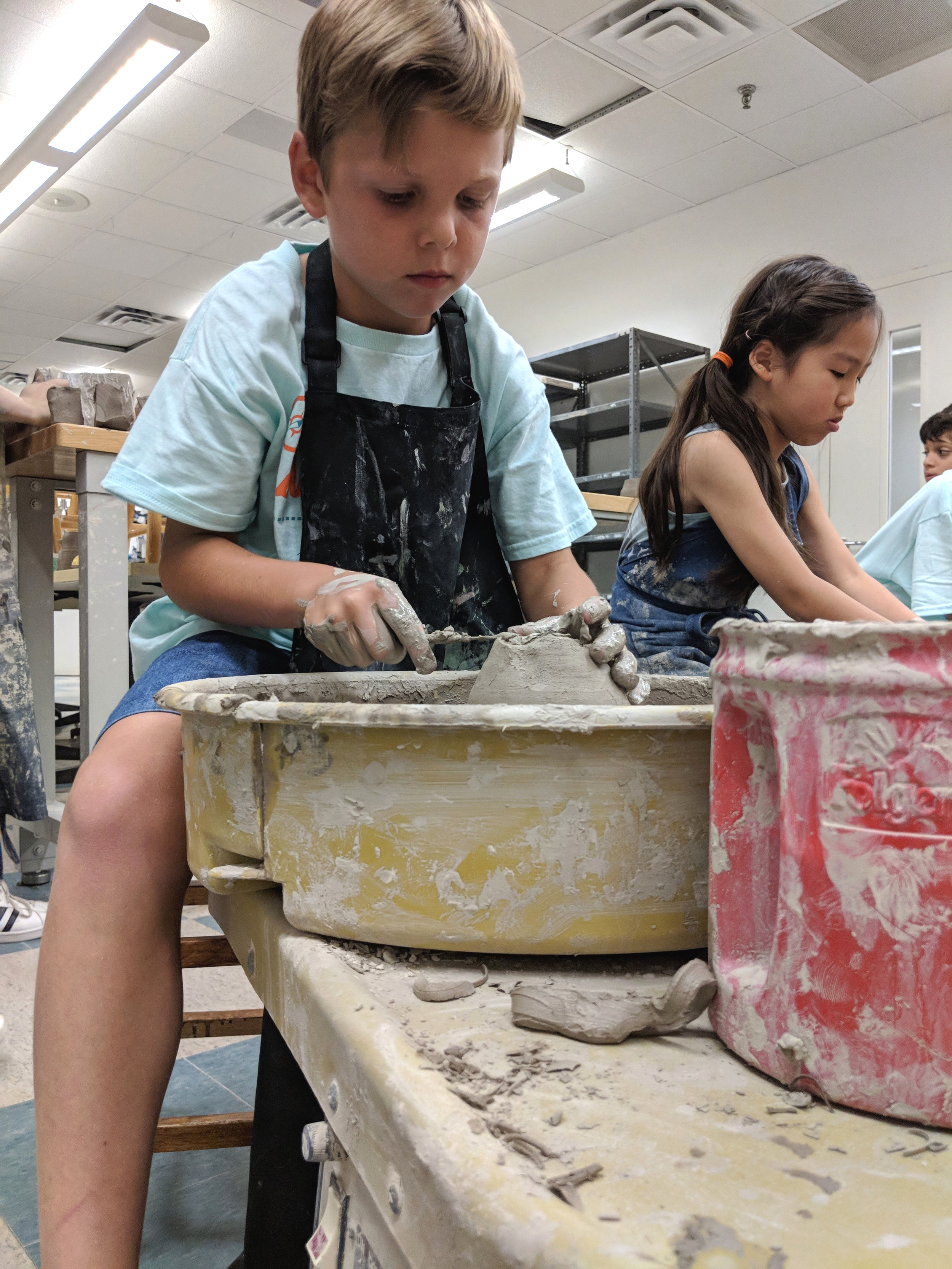 Boy enjoys Pottery Wheel summer camp at Parish Summer in Dallas, Texas.