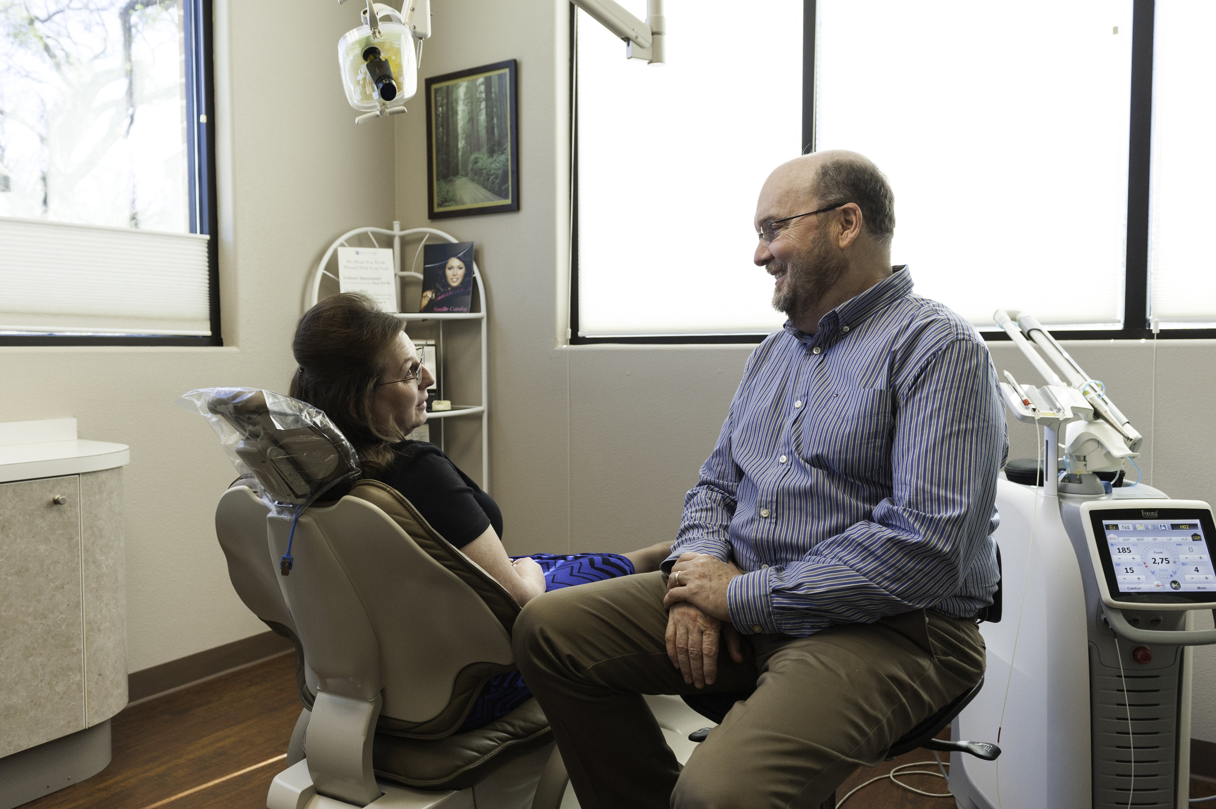 Dr. Flower explaining dental implants to a patient