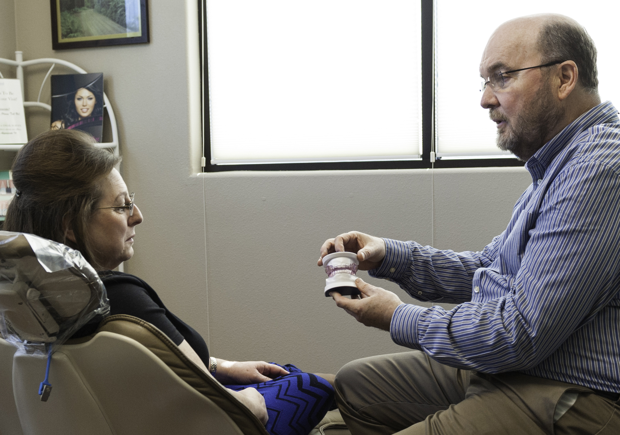 Dr. Flower Explains Dental Implants to a patient at his Carrollton TX office