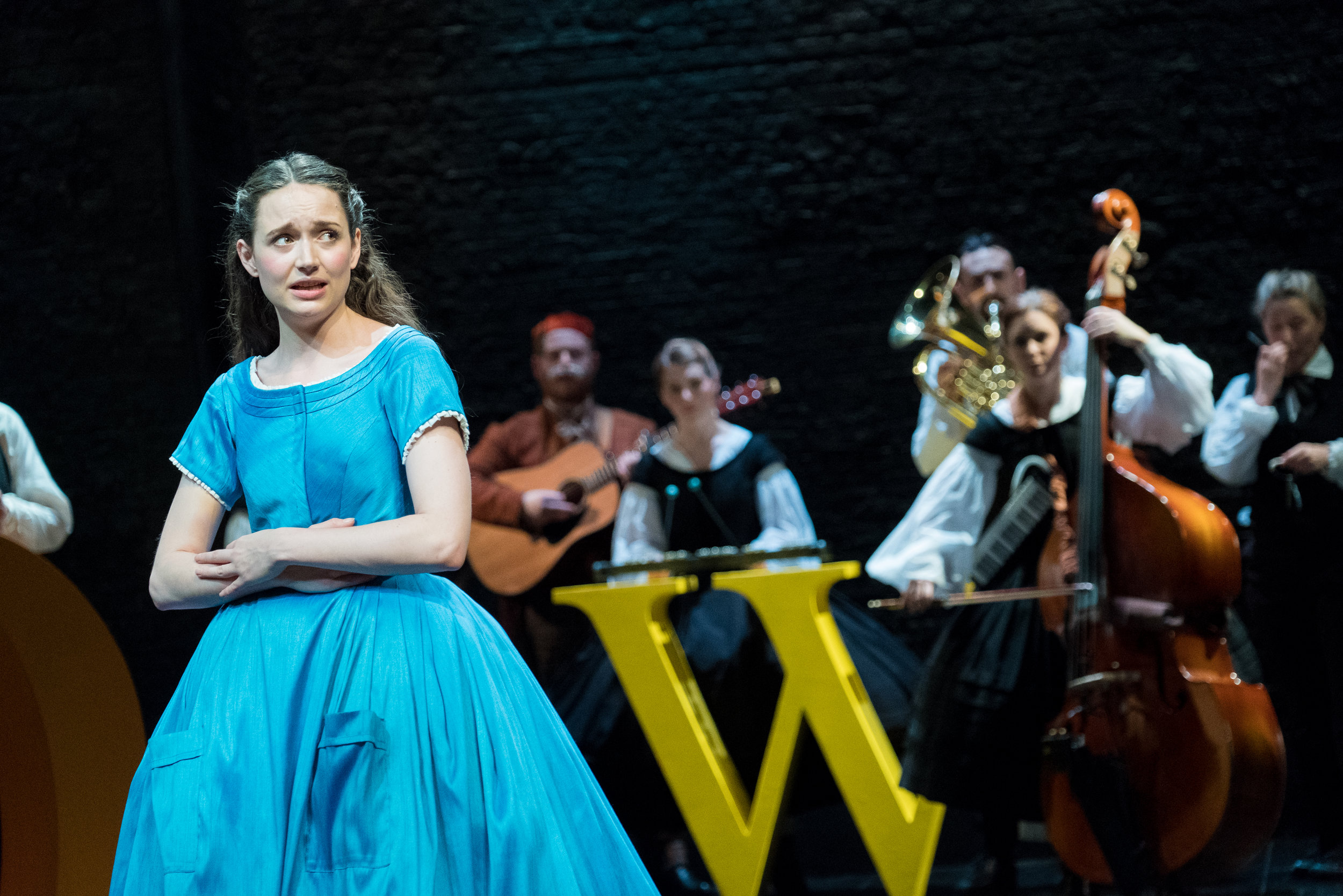 Rebecca Birch & cast in Alice in Wonderland, Storyhouse, composed by Jude Obermüller (photo by Mark McNulty)
