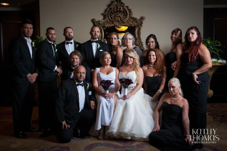 Lisa Stoner Events - Central Florida Luxury Weddings - Orlando Weddings - Downtown Orlando - Grand Bohemian Hotel - Kathy Thomas Photography - black tie wedding - same sex wedding - LGBTQ - Marriage Equality - Vanity Fair backdrop - wedding party.jpg