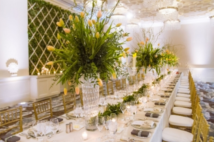 lisa stoner events- luxury central florida weddings- feasting tables- yellow tulip centerpieces - gold chiavari chairs- crystal candelabra.jpg