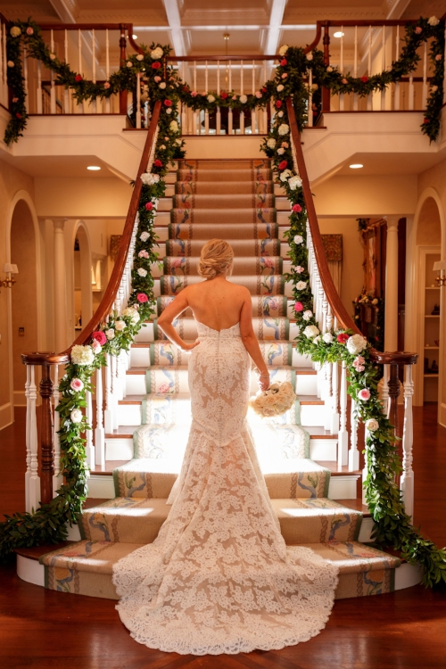 lisa stoner events - stairs with floral rope - bride- central florida luxury weddings- orlando stylish weddings - lace wedding gown, mermaid wedding gown.jpg