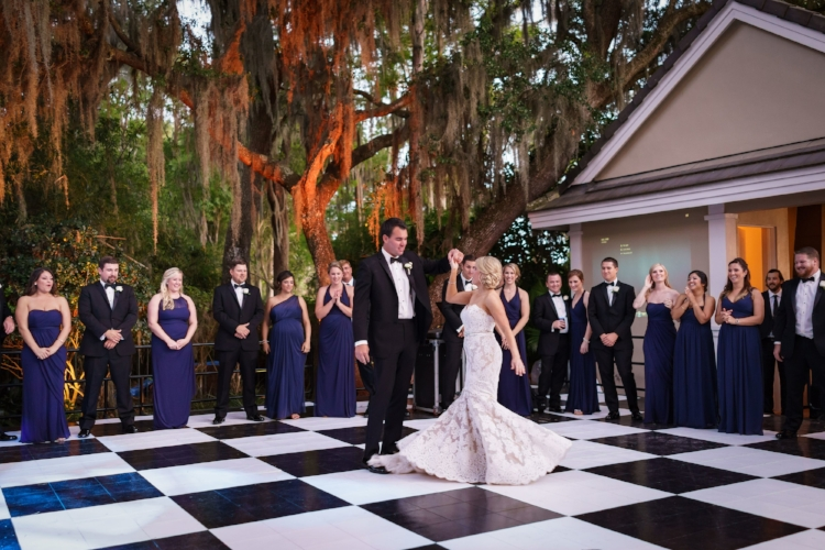 lisa stoner evnts- central florida outdoor wedding receptions- black and white dance floor- plum bridemaids dresses - luxury wedding planner in orlando - first dance.jpg
