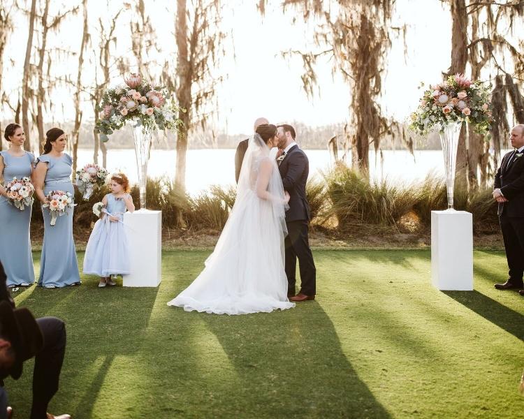 lisa stoner events - central florida outdoor wedding ceremony - elegant central florida outdoor wedding ceremony- flower girl - first kiss - luxury windermere wedding planner.jpg