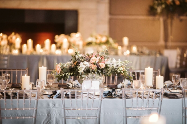 lisa stoner events- clear chiavari chairs- slate grey linen - pink and grey wedding - wedding reception with pillar candles.jpg
