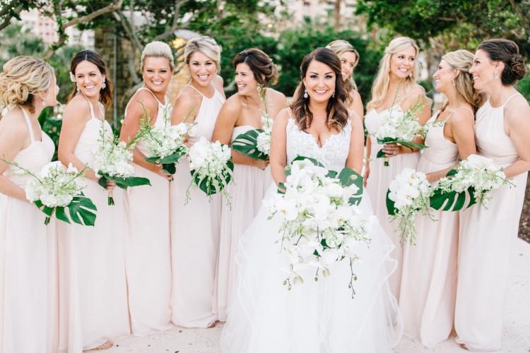 lisa stoner weddings- florida destination wedding planning expert- bridal party - bride with wedding party - unique wedding bouquets- white orchid wedding bouquets.jpg
