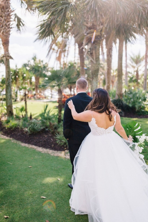 lisa stoner event planning- high end wedding planning in florida- hammock beach resort- first look- bride and groom- outdoor wedding ceremony.jpg