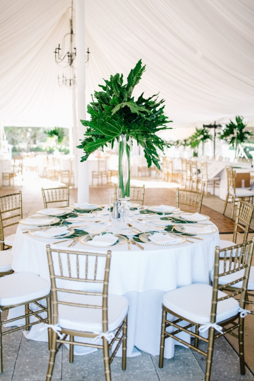 lisa stoner event planning- luxury tented wedding in florida- hammock beach tented wedding- white draping in a tent- gold chiavari chairs- palm coast tented wedding.jpg