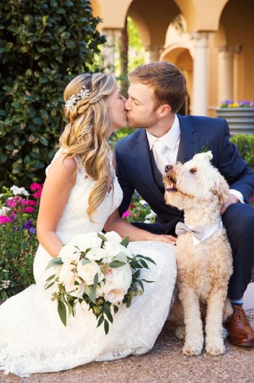 ritz carlton weddings- bride and groom - bride and groom with dog- dogs in weddings- lisa stoner weddings- orlando wedding planner - dog in a bow tie.jpg