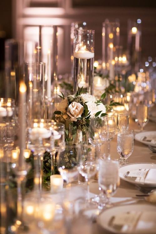luxury wedding reception - floating candles- luxury wedding reception - long wedding reception tables- elegant orlando weddings - lisa stoner wevent planning.jpg