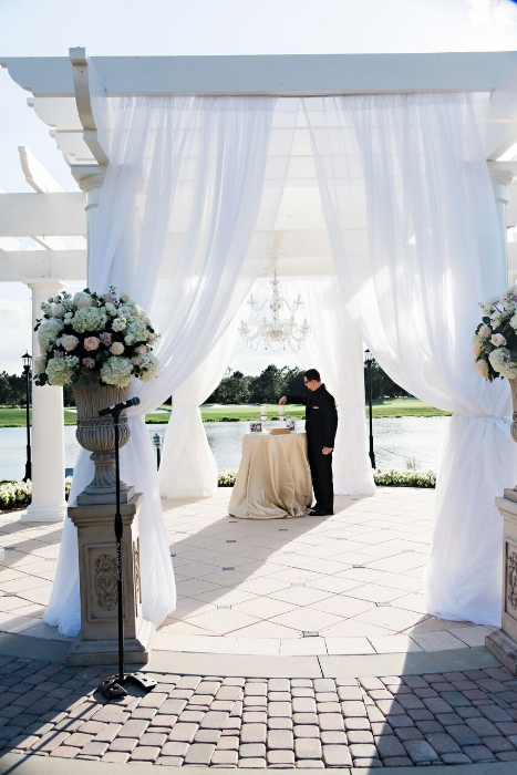 lisa stoner events- aisle decor - ritz cartlon grande lakes - white wedding gazebo- orlando luxury wedding planner - white ceremony flowers.jpg