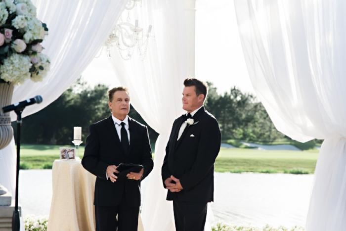 ritz carlton orlando outdoor wedding- ritz carlton grande lakes black tie wedding- sensational ceremonies- black tie wedding- groom- orlando lakeside wedding ceremony.jpg