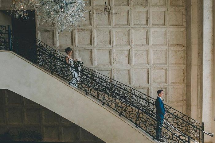 four seasons orlando grand staricase - lisa stoner weddings- first look - bride and groom- stylish orlando wedding- four seasons.jpg