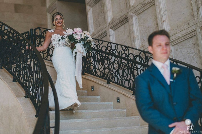 four seasons orlando - four seasons orlando grand staircase -blue suit for groom- pronovias gown- pink and white bridal bouquet - first look.jpg