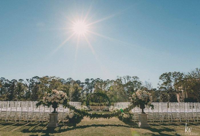 lisa stoner events- orlando sunset wedding ceremony - four seasons at walt disney world resort- white chiavari chairs- luxury orlando wedding.jpg