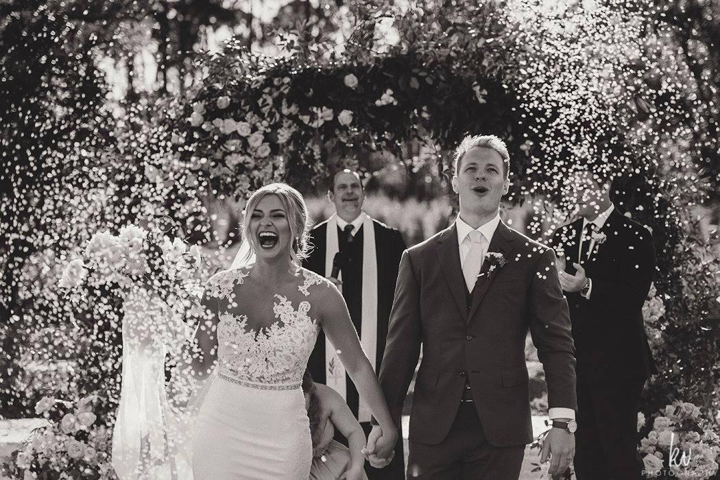lisa stoner events- four seasons orlando - outdoor orlando wedding- confetti at wedding ceremony - orlando sunset wedding ceremony.jpg