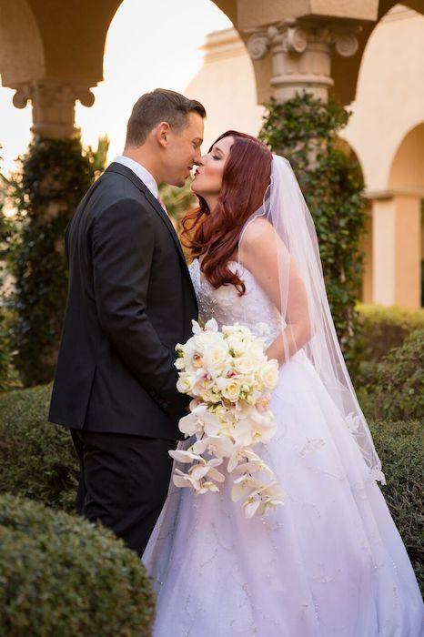 8-Lisa Stoner Events- Ritz Carlton Orlando – Orlando luxury wedding planner – Ritz Carlton Orlando wedding-first kiss.jpg