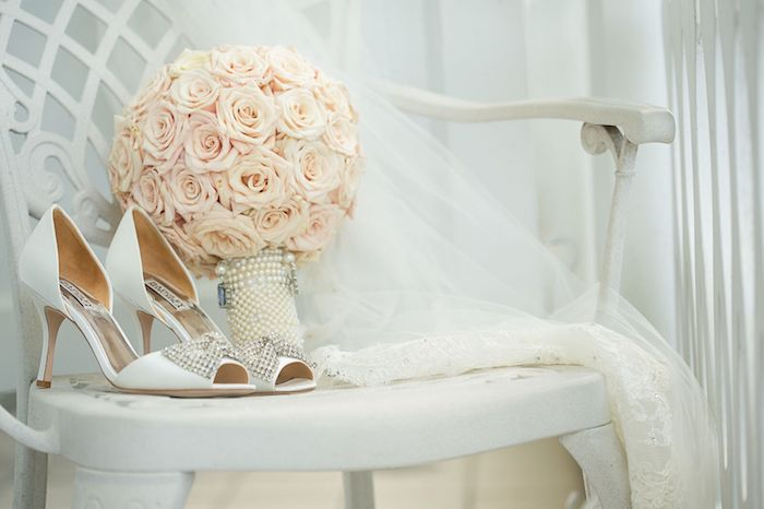 Lisa Stoner Events – Lisa Stoner Wedding - Orlando luxury wedding planner- Ritz Carlton Orlando - pink rose brideal bouquet - Badgely Mischka shoes.jpg