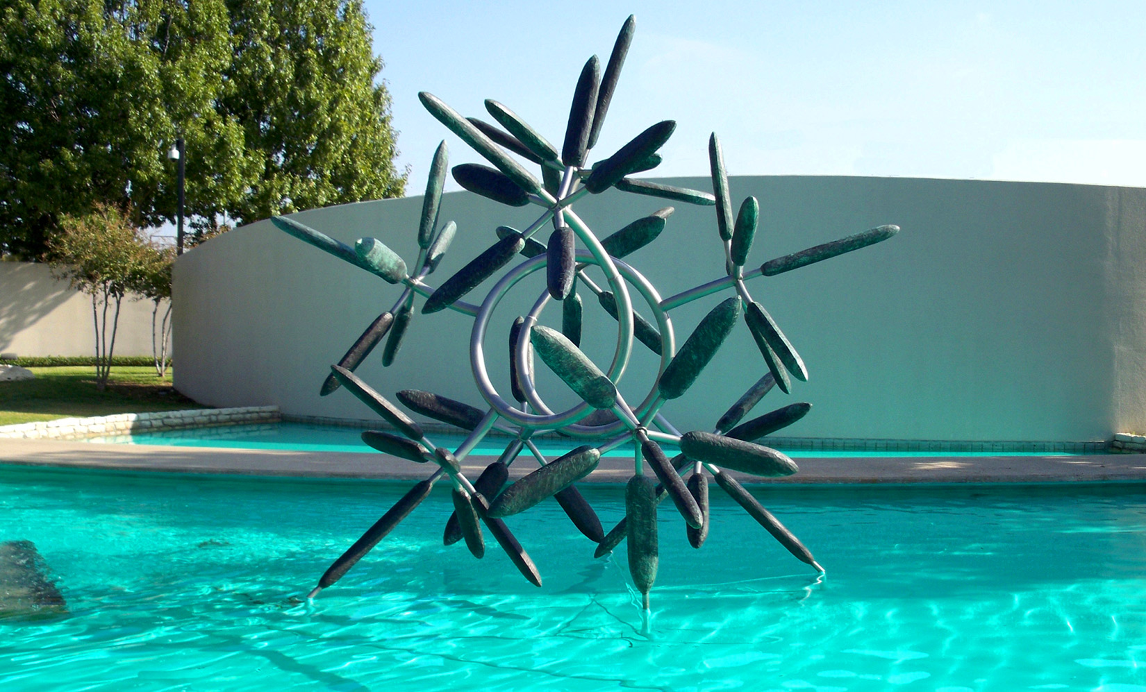 "Star Flower , 2008 Bronze and Stainless steel 156"" x 168"" x 156""  In the collection of The Irving Arts Center, Irving, TX"