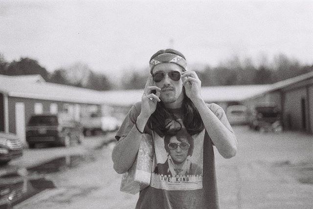 😎 #cassidychreenephoto #canonae1 #canon #filmphotographyproject #filmisnotdead #sheshootsfilm #blackandwhitefilmphotography #ilford400 #ilford #portrait #sunglasses #longhairdontcare #bandana #elvis #theking