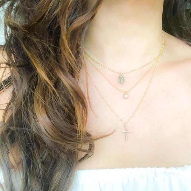The perfect layering. Mini Celtic cross, the pearl neck and cross neck.
