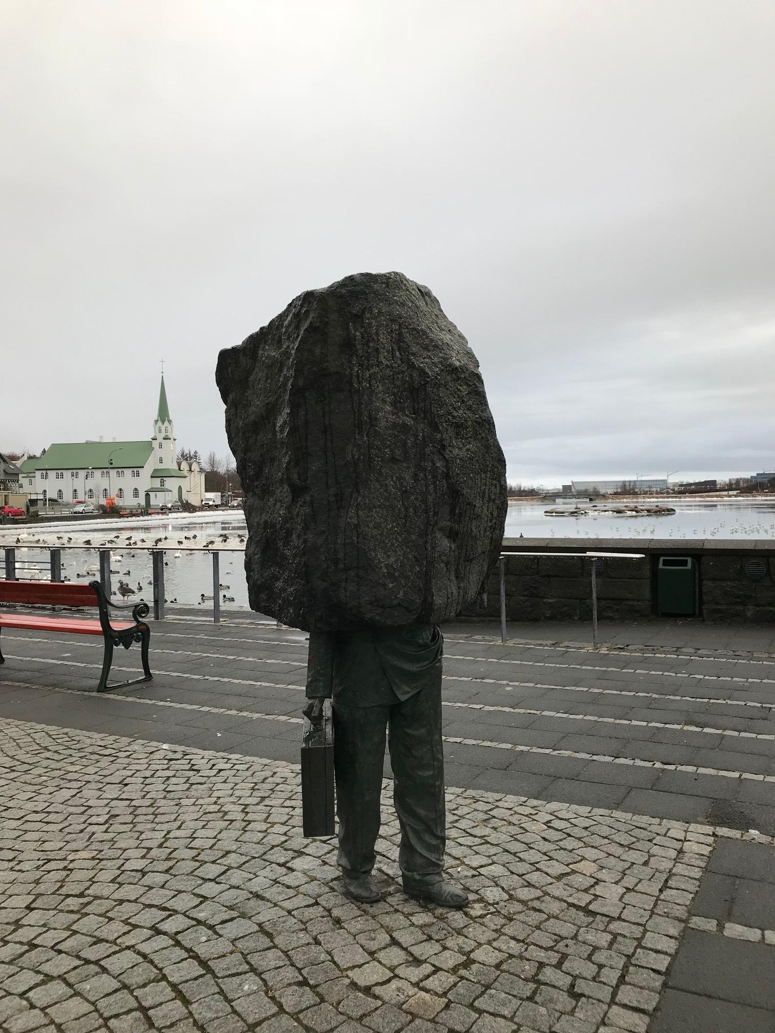 The Unknown Bureaucrat statue found near Tjornin Pond