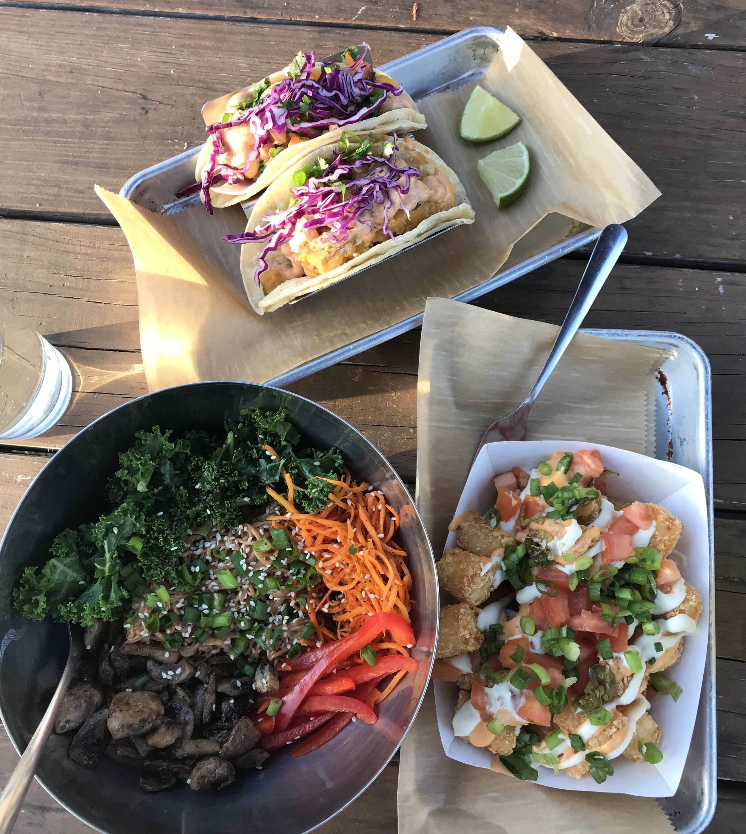 Fish tacos, Korean noodle salad and loaded tater tots from Curia Off the Drag in Gainesville, Florida. Look for all-vegan restaurants in your area for the best vegan food swaps!