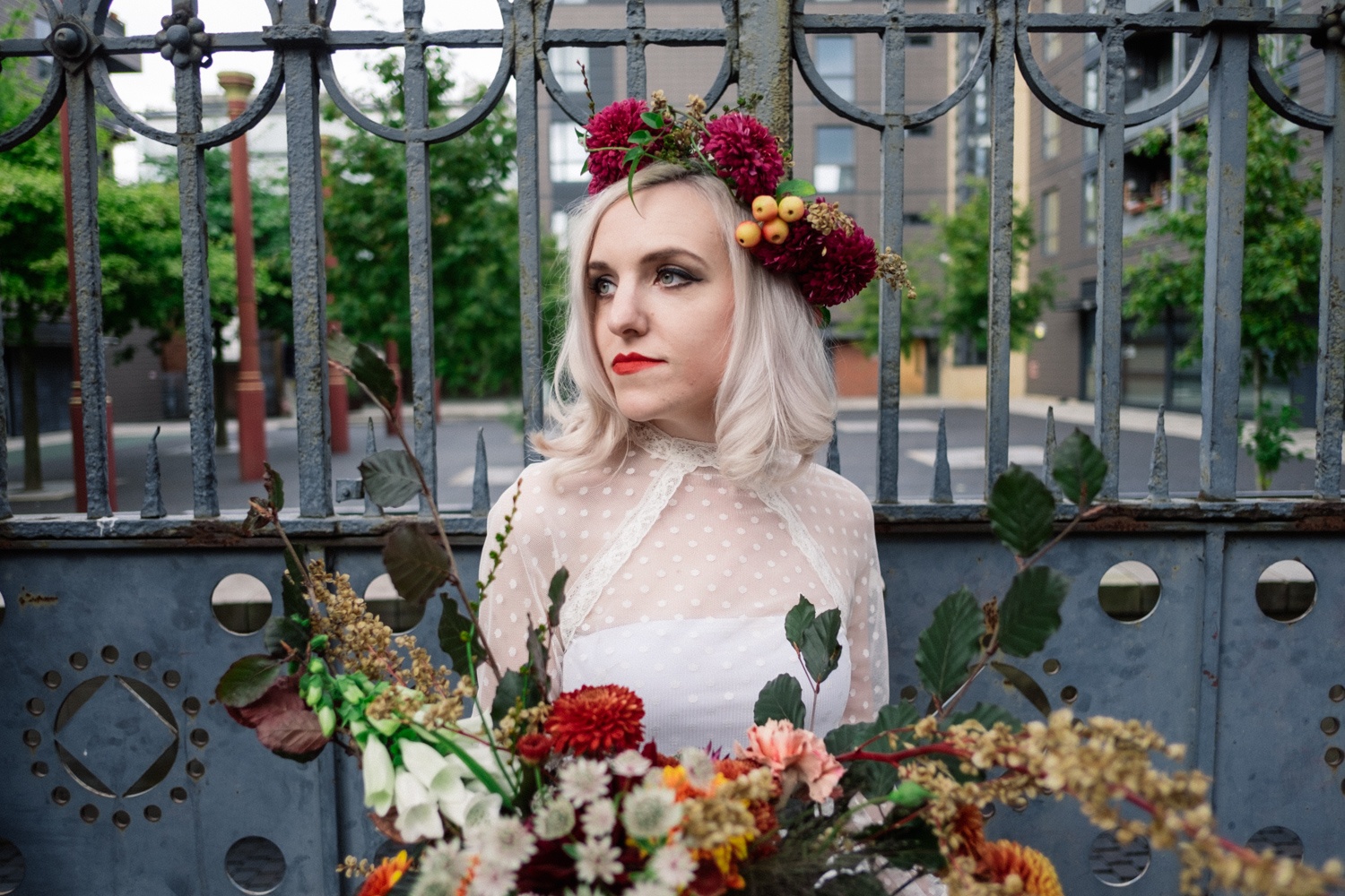 Martha holds bouquet in Manchester Northern Quarter