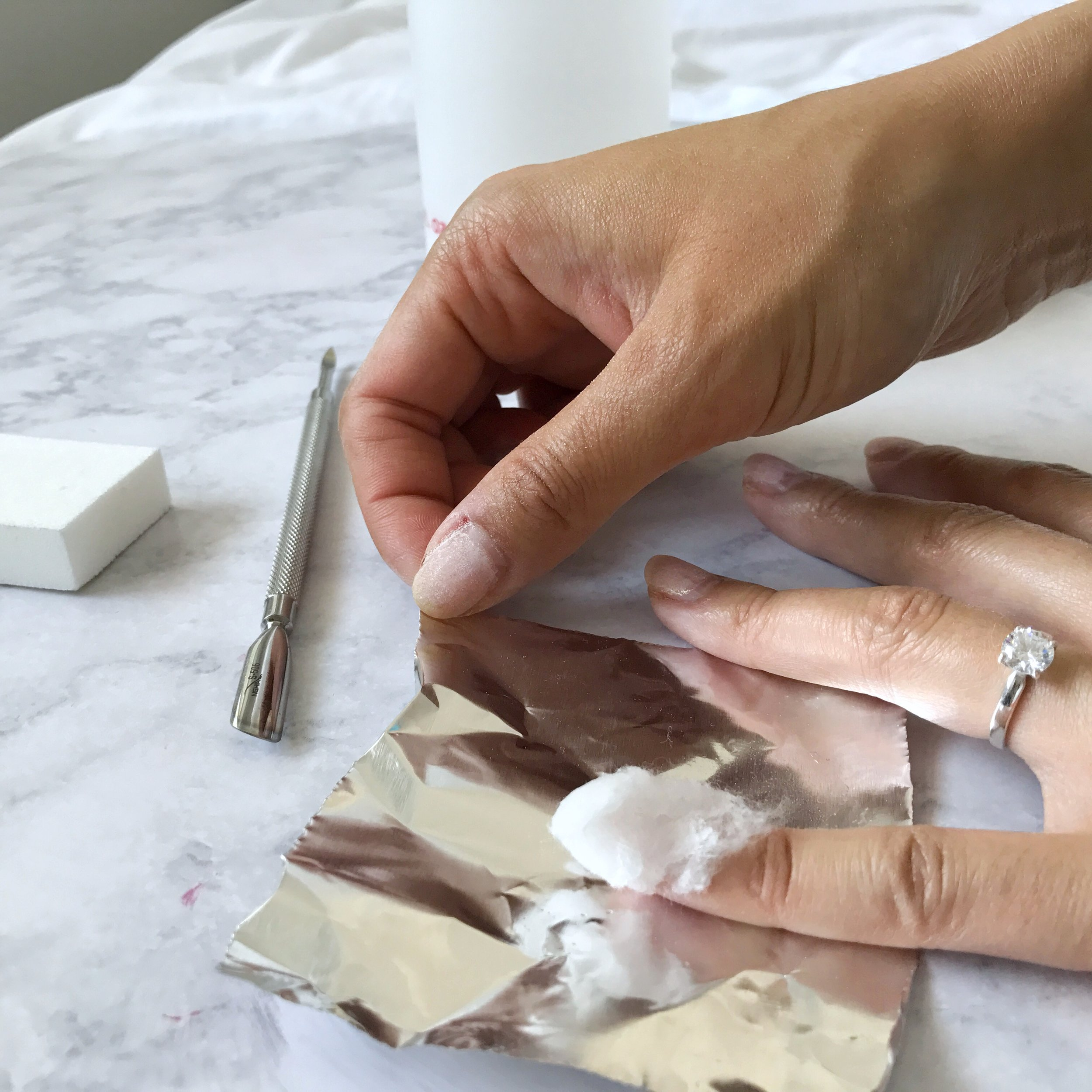 Place cotton on top of nail