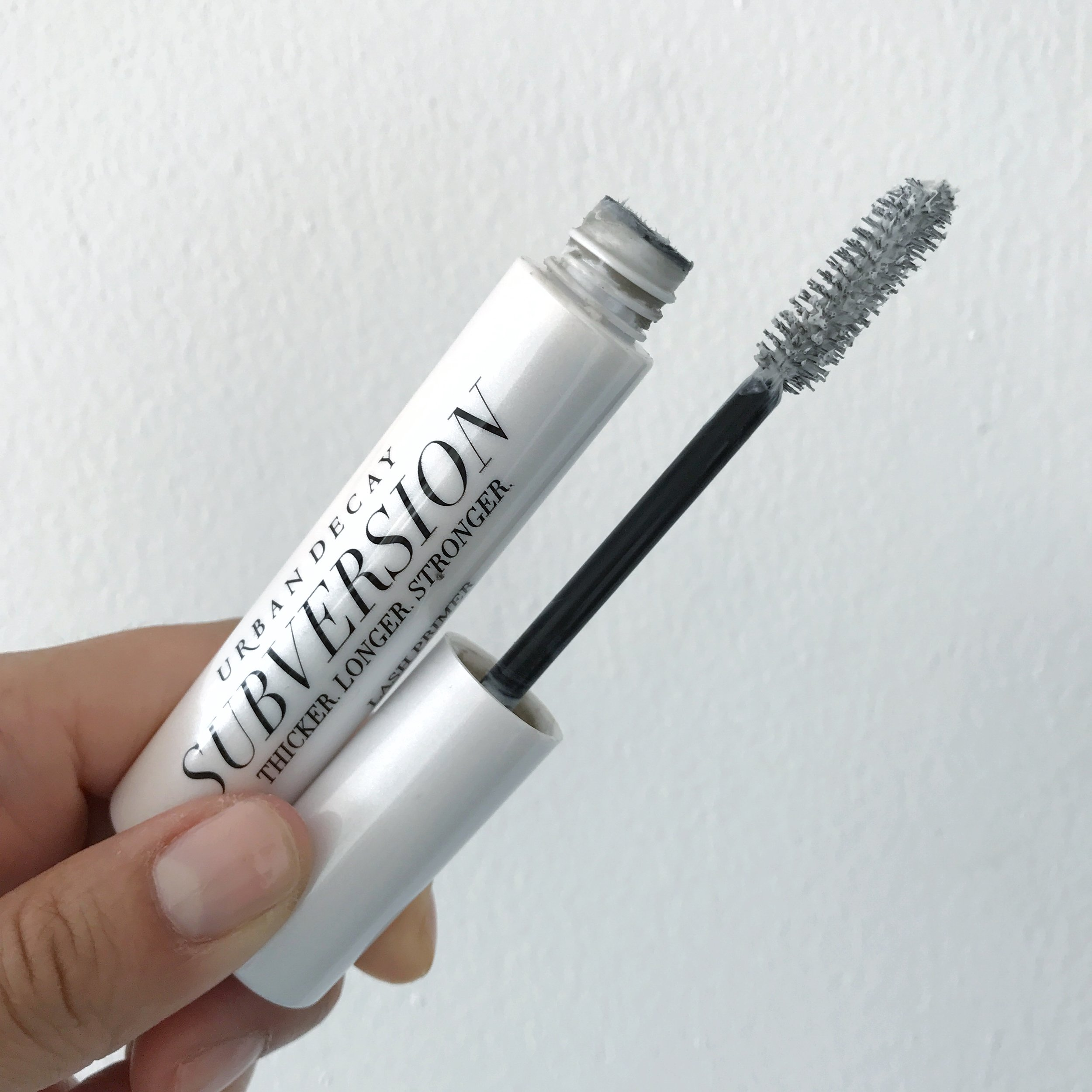 Tip: Apply  lash primer  generously to one eye first. While primer is still wet, apply mascara over it. Don't worry the white will disappear.