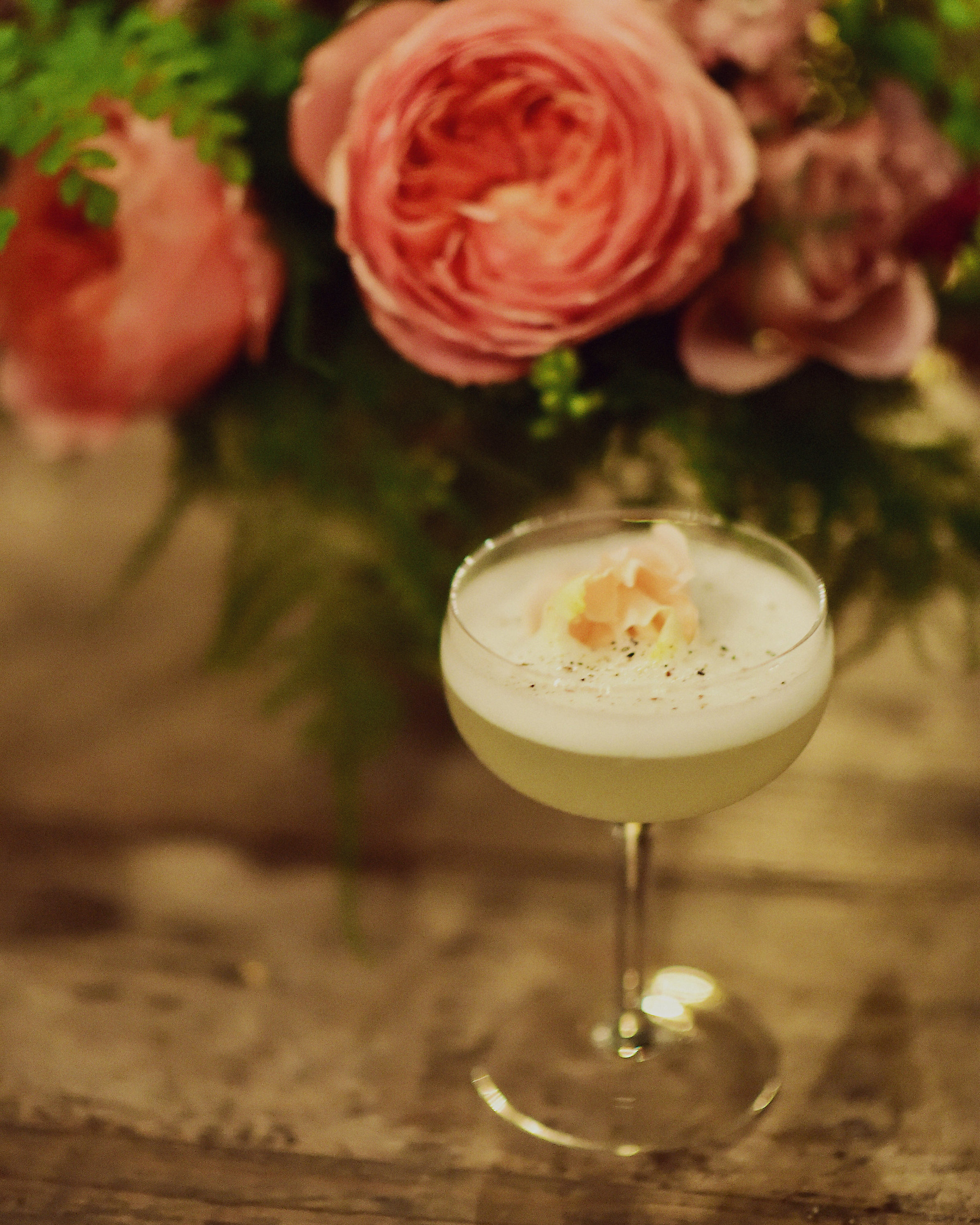 THE SHOWGIRL   fresh pressed pineapple and lime, house rose syrup, cracked black pepper, vodka