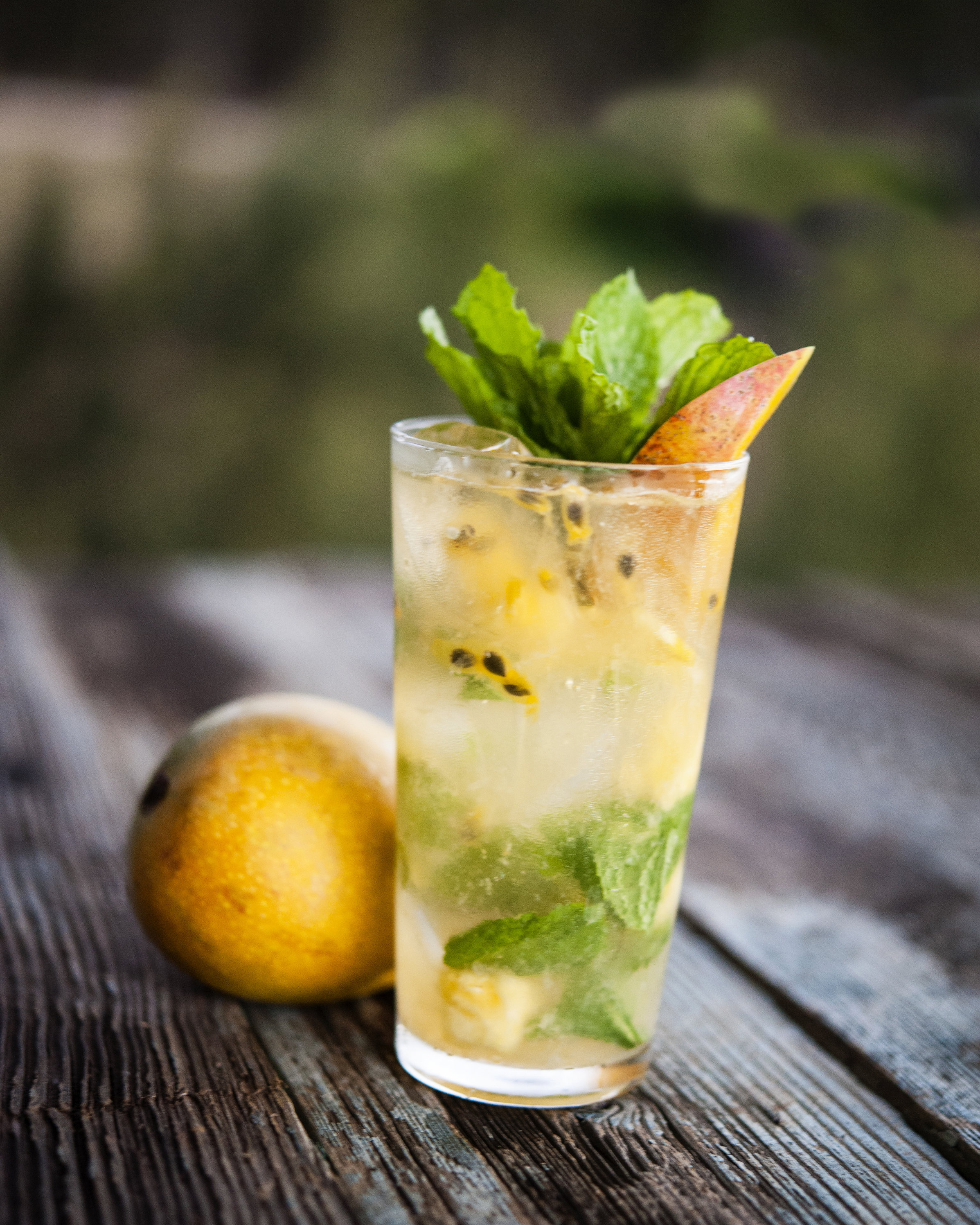 TROPIC   garden mint, fresh pressed pineapple, mango and lime, lilikoi, charged water, golden rum