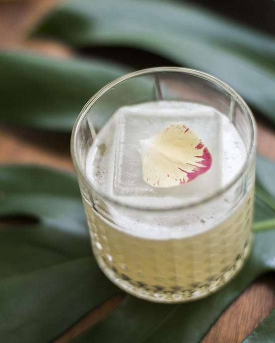 CAUGHT IN THE RAIN   fresh pressed pineapple and lime, coconut water, aromatic bitters, coconut ice, golden rum