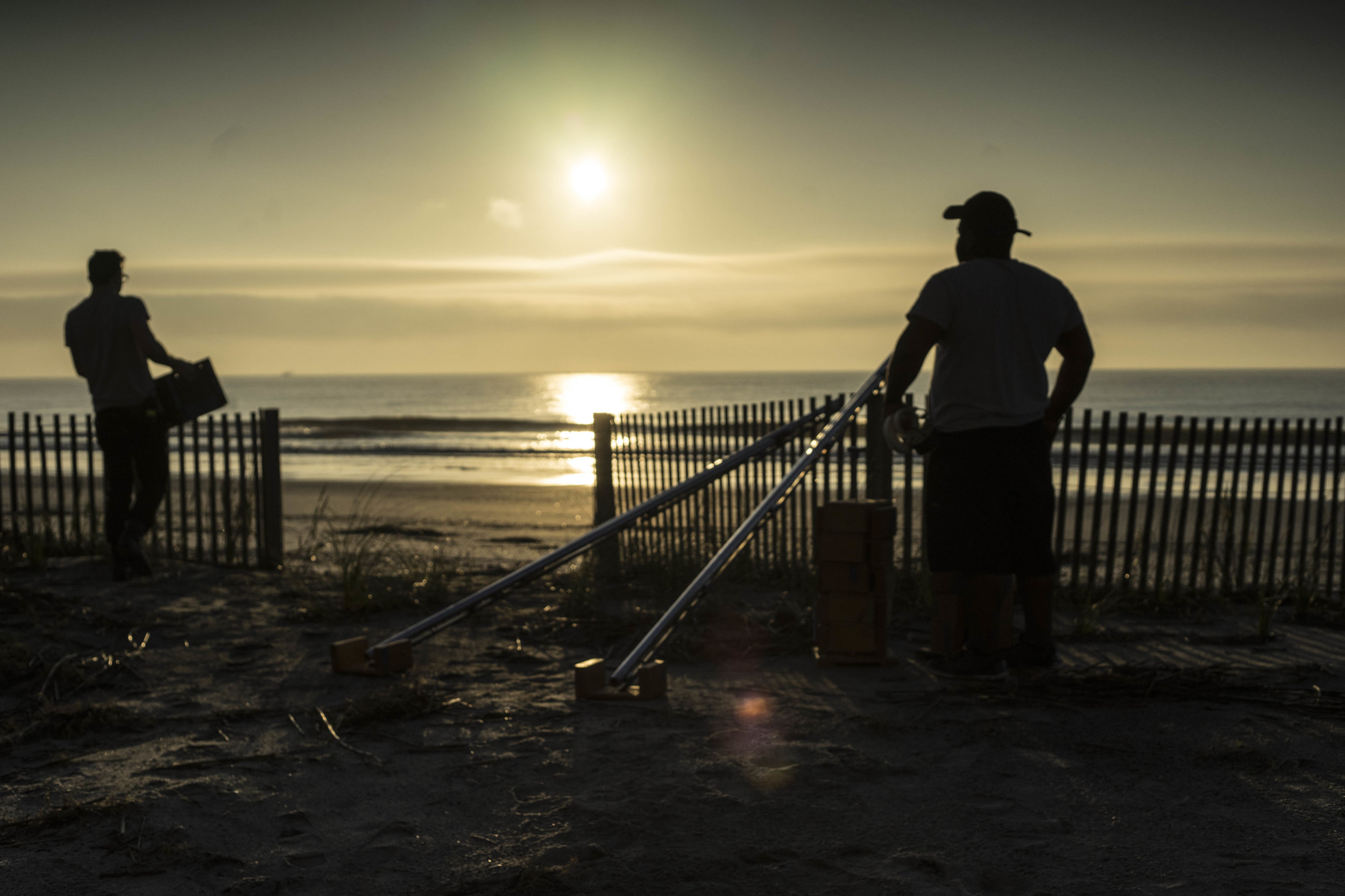 Professional crew and TTC students prepare a shot as the sun rises over Folly Beach, SC, on the set of INDIE GRANTS short  Isle of Palms .