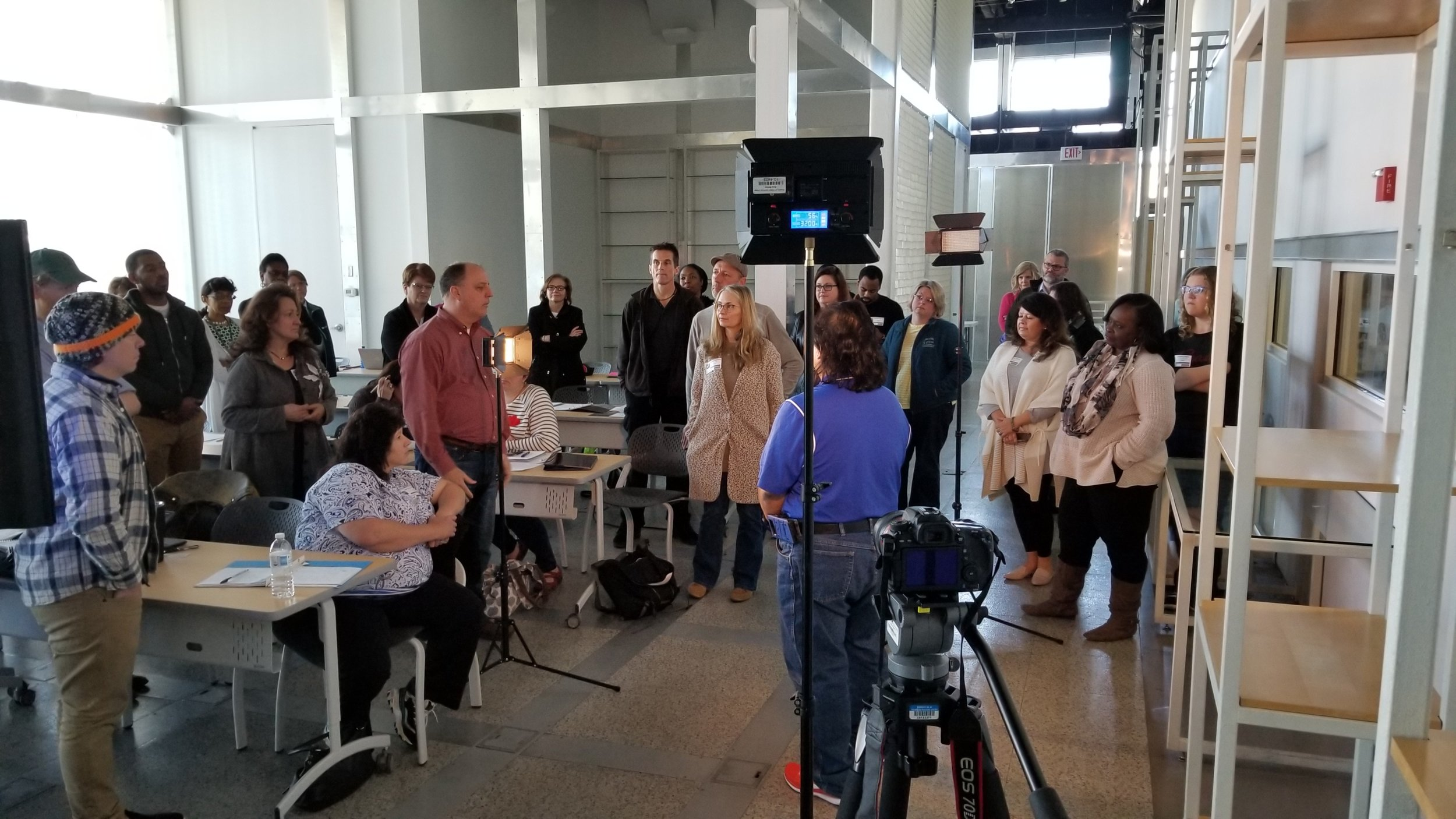 Trident Technical College instructor Mark Bradley goes through the basics of lighting and LED lighting equipment with educators from across the state.