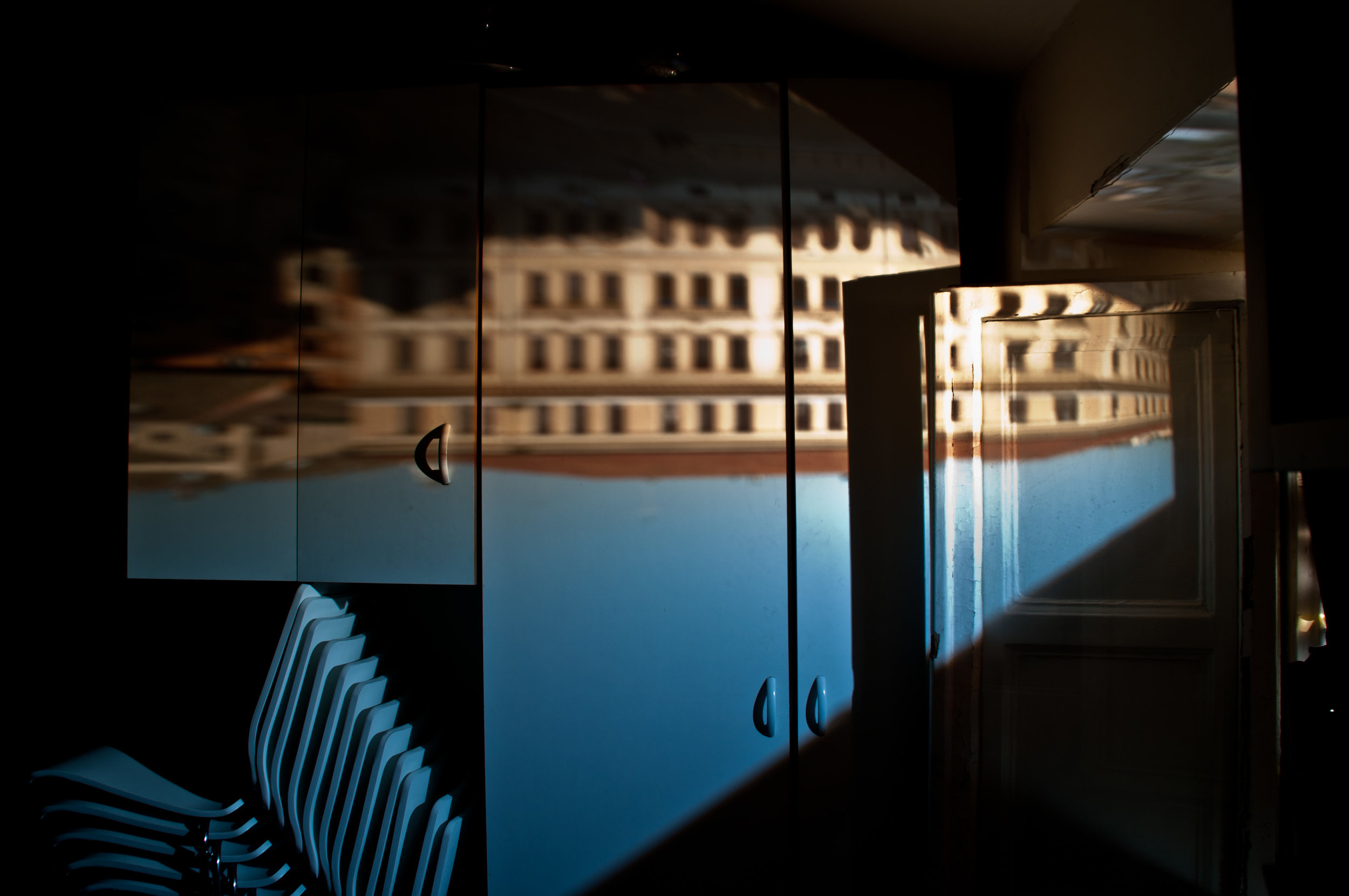 I created this camera obscura while I was studying architecture in Rome. It's the local piazza (city square) reflected into a small kitchen apartment one of my classmates lived in.