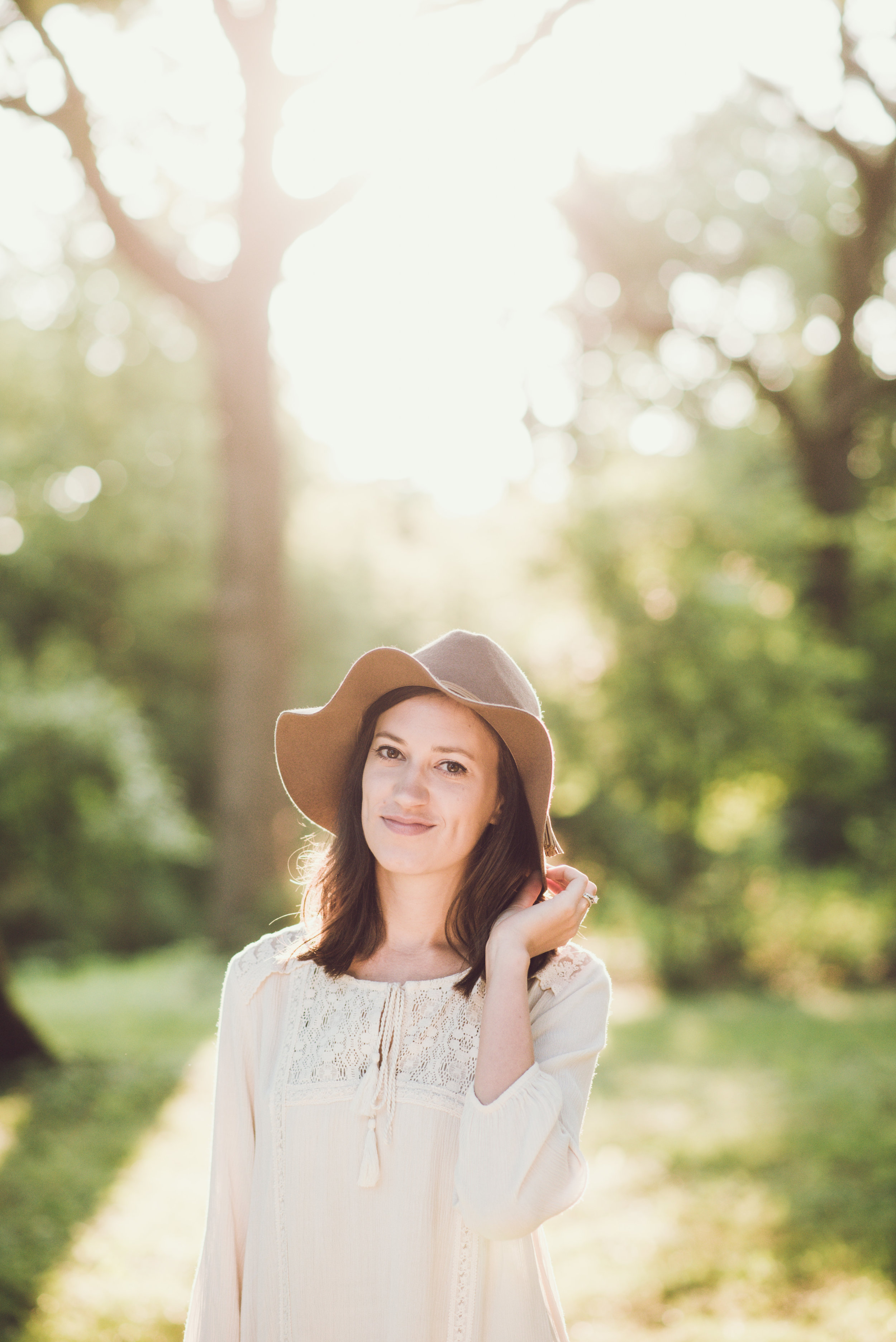 This is my wife, Allison. We decided to go out to the rose garden one morning and she looked beautiful in the light. She's absolutely amazing and I wouldn't be half the person I am without her.