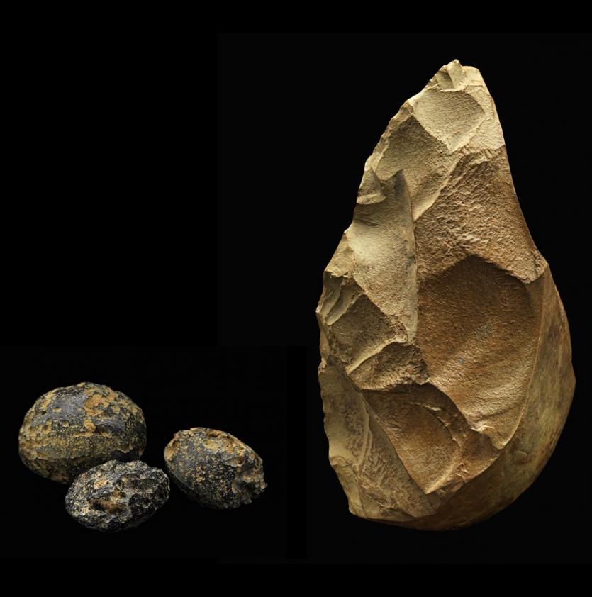 """Smithsonian scientists and their Chinese colleagues found this and other handaxes in the same sediment layer with tektites, small rocks that formed during a meteor impact 803,000 years ago.  Since the handaxes and tektites were in the same layer, both are the same age. Early humans must have moved into the area right after the impact. They may have made the handaxes from rocks that were exposed when forests burned.""\(^{[1]}\) Image Credit:  James Di Loreto, & Donald H. Hurlbert, Smithsonian Institution"